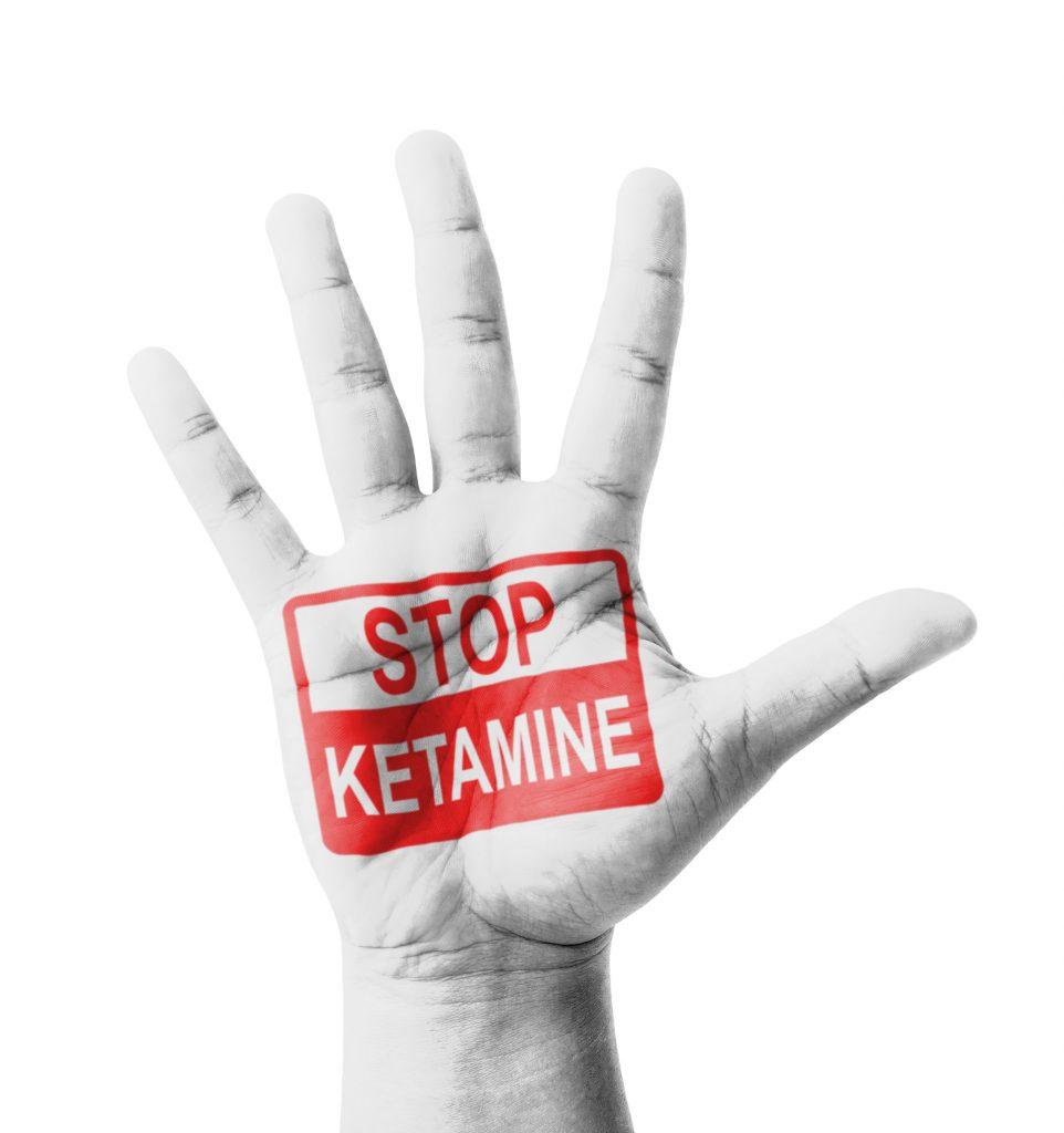 Open hand raised, Stop Ketamine Addiction sign painted
